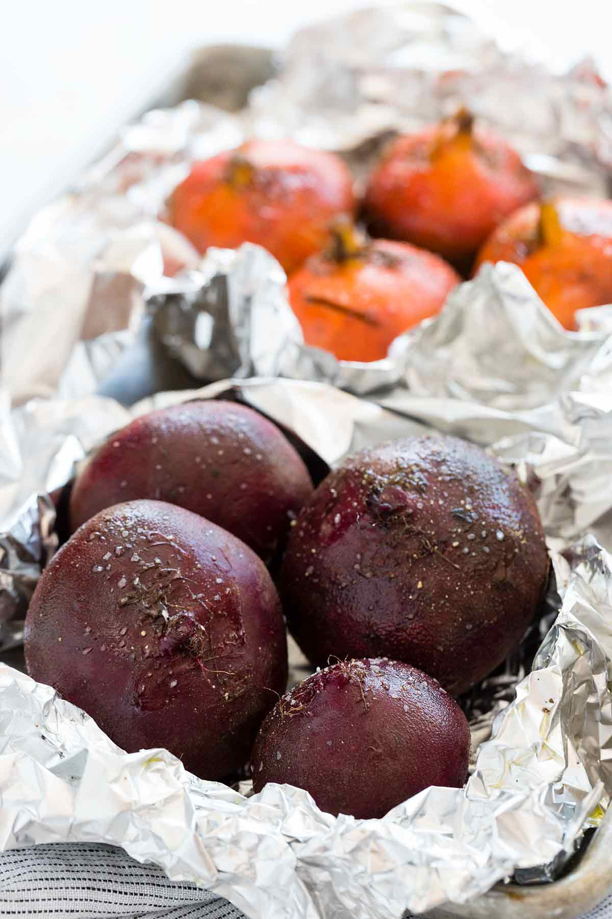 whole roasting purple and gold beets in aluminum foil