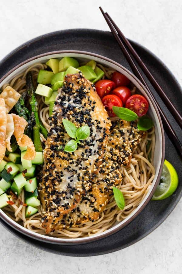 Photo of a bowl with sesame crusted fish and vegetables