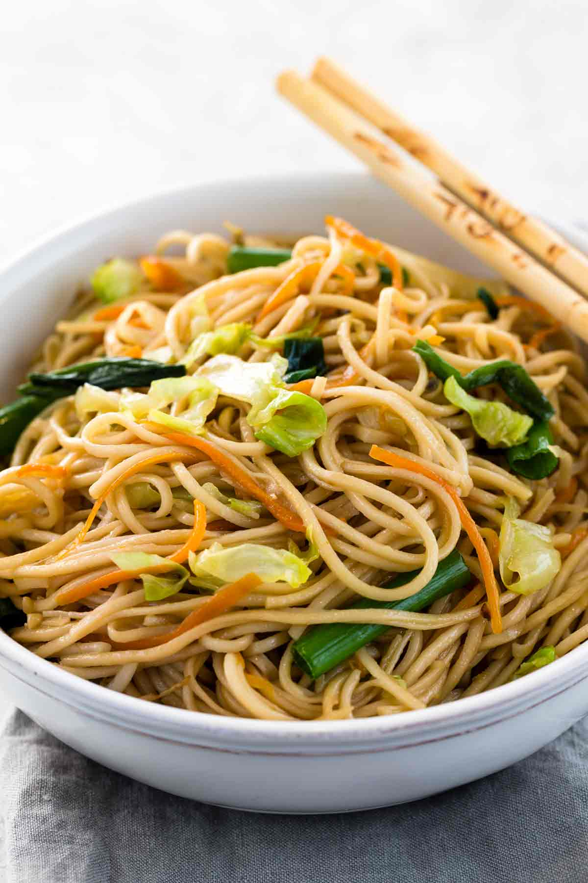 Chow mein recipe jessica gavin chopsticks on a white bowl filled with chow mein and vegetables freerunsca Gallery
