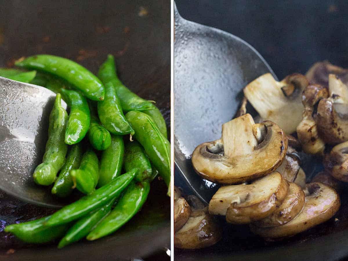 Sugar snap peas and mushrooms cooking in a wok