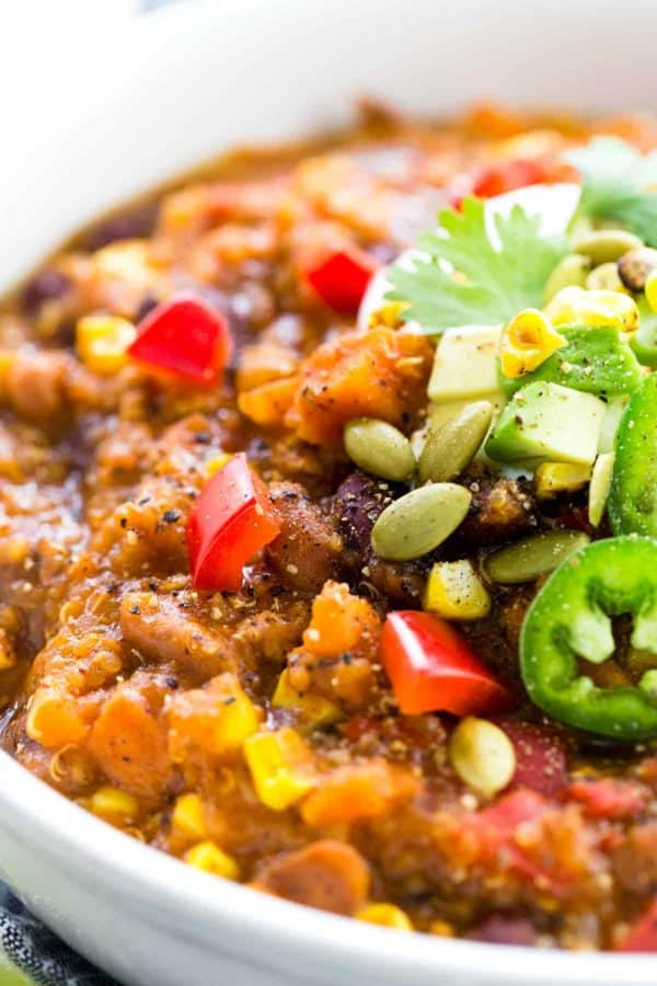 Close up photo showing bowl of turkey chili with garnish