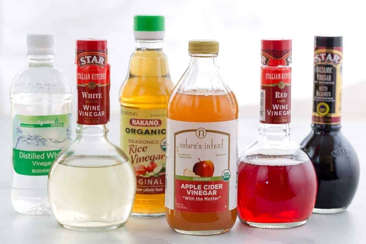 Six bottles of different varieties of vinegar