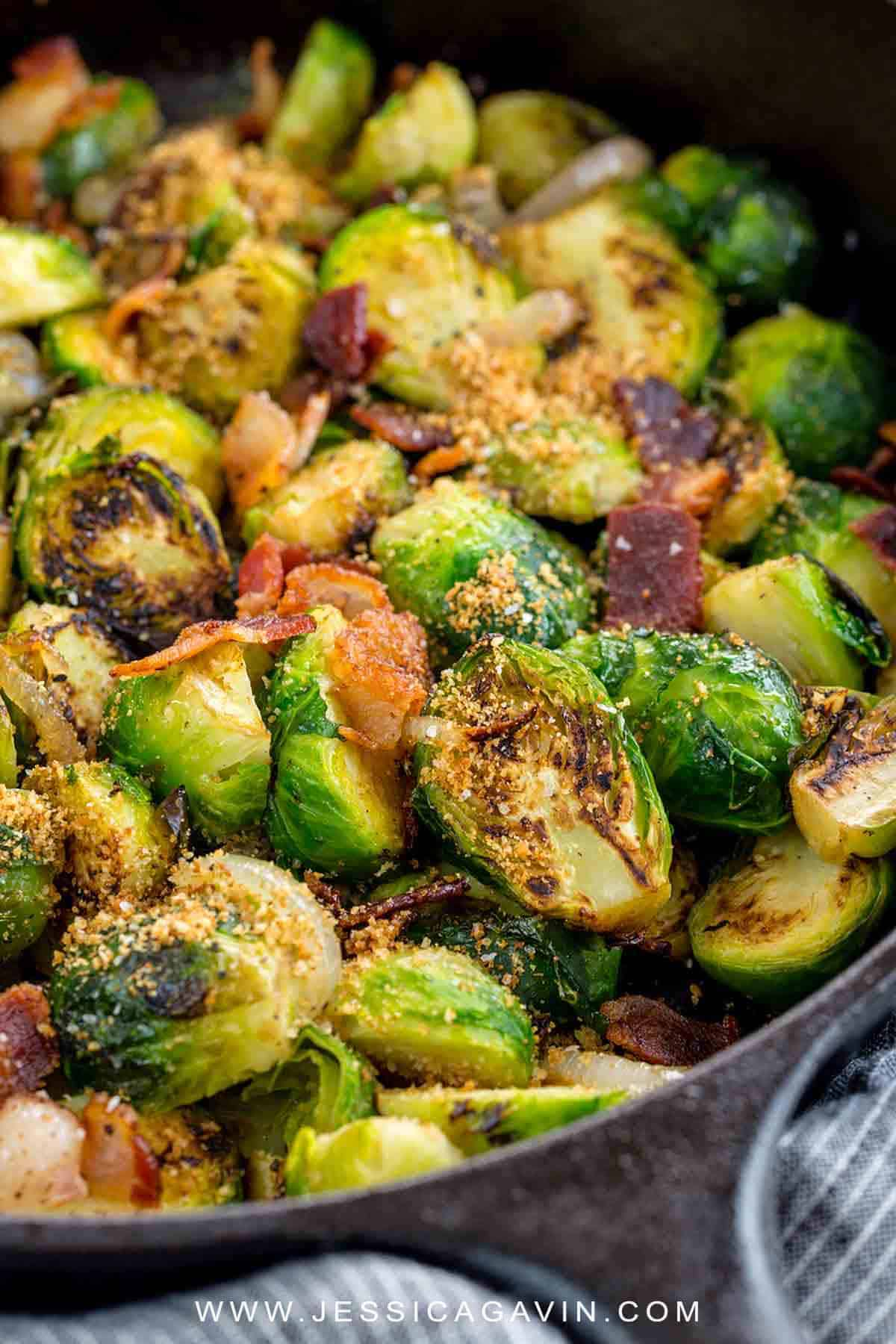 Sautéed Brussels sprouts with bacon will be your new favorite side dish! These green sprouts are topped with crunchy breadcrumbs and served with savory hickory smoked bacon. #brusselssprouts #sidedish #thanksgiving