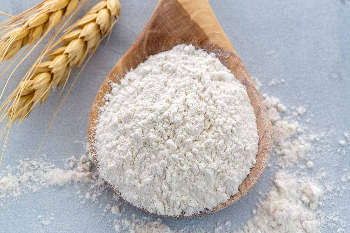 Wheat flour in a wooden spoon