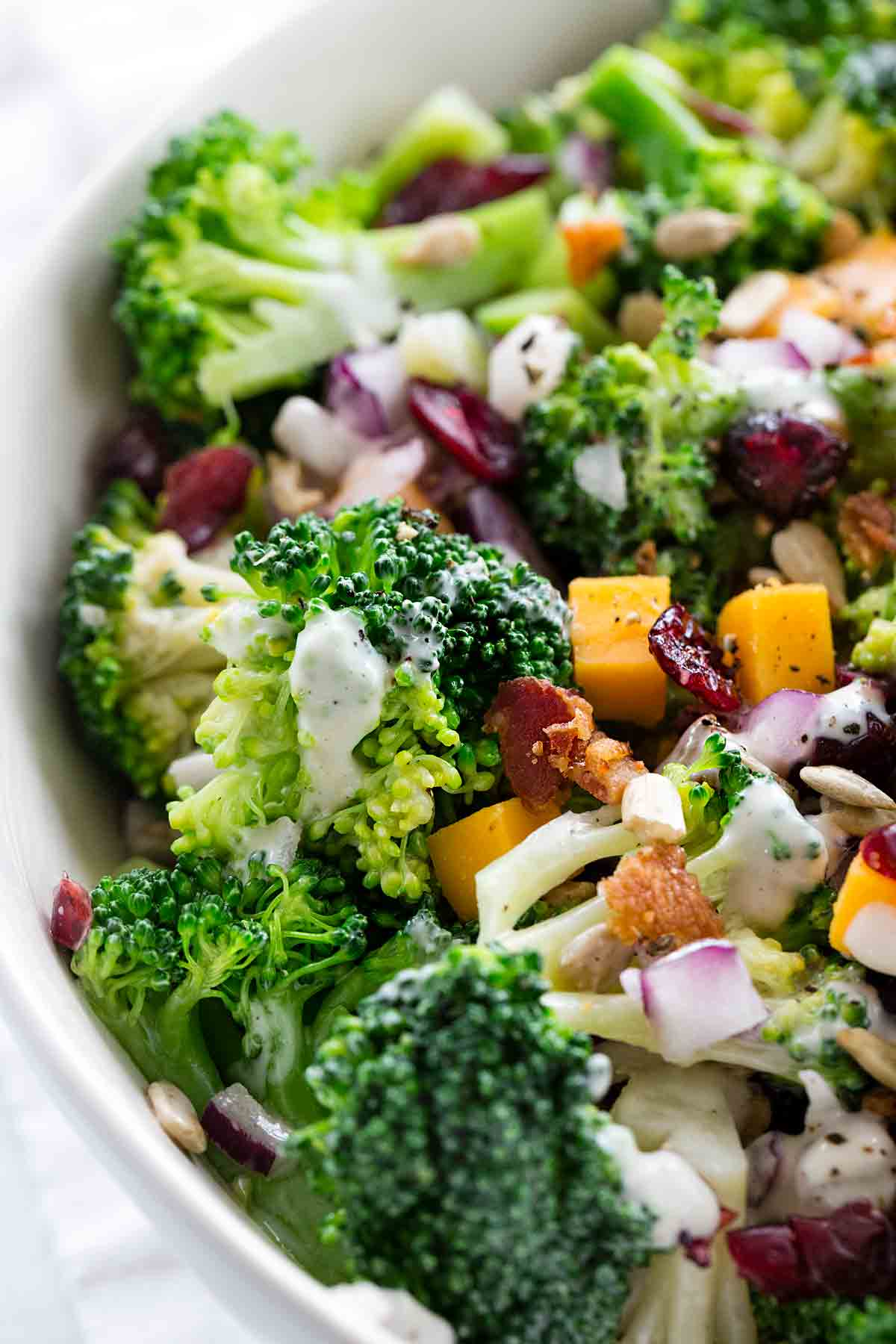Close up view of broccoli salad with creamy dressing