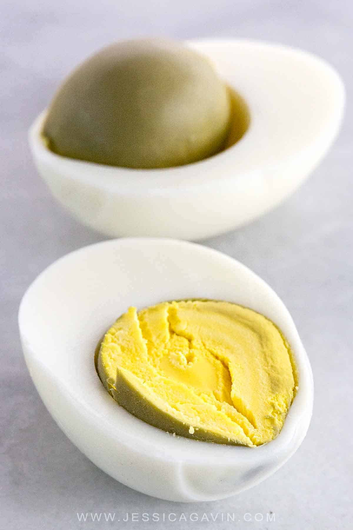Perfect hard-boiled eggs have tender whites and opaque yellow yolks, but cooked too long and the middle turns green. Learn why this color change happens and why there's a strong odor that follows. #eggscience #greenegg #rotteneggs