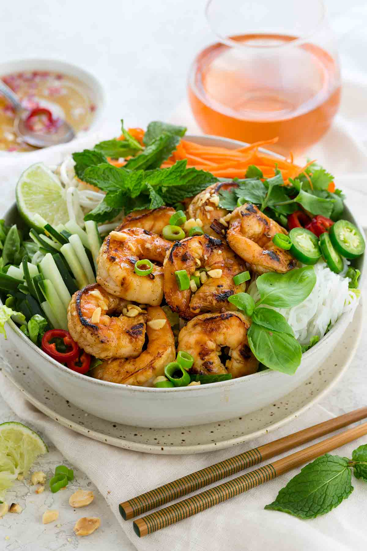 Photo of a beautiful bowl of shrimp salad with Asian-style ingredients