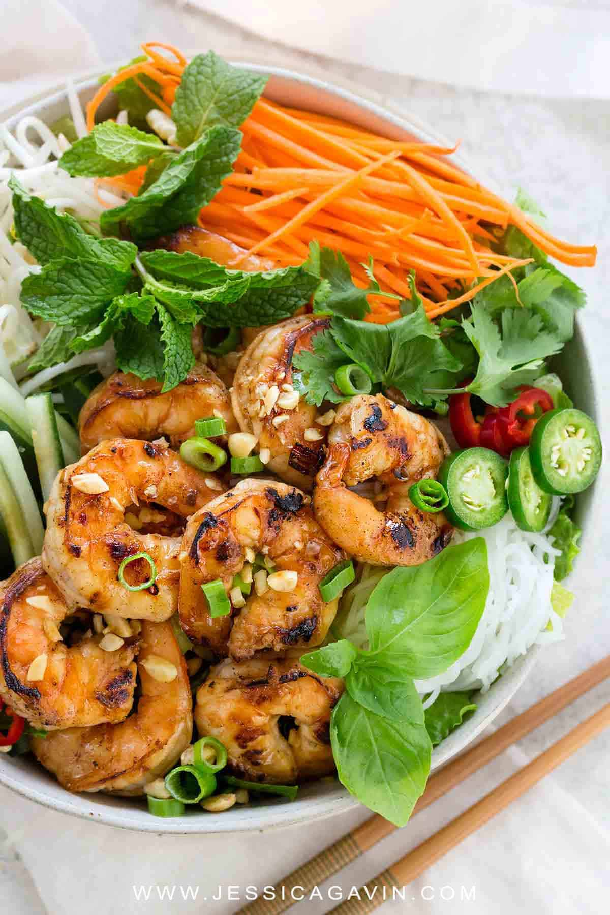Vietnamese shrimp salad is a light meal packed with bold flavors and serious crunch. A traditional rice noodle salad loaded with seared shrimp, crisp vegetables, and an irresistible nuoc cham sauce. #shrimpsalad #vietnamese #glutenfree