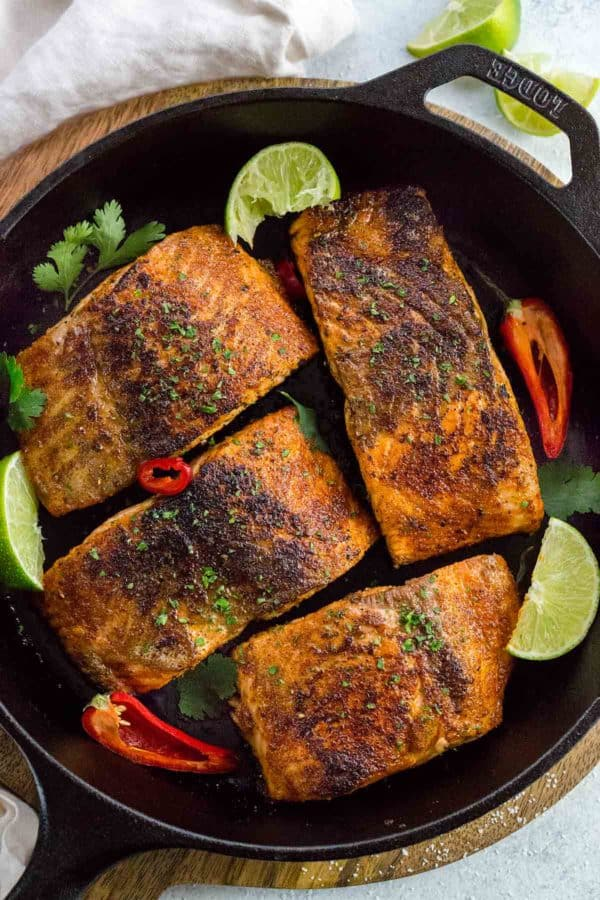 Blackened salmon fillets in a cast iron skillet