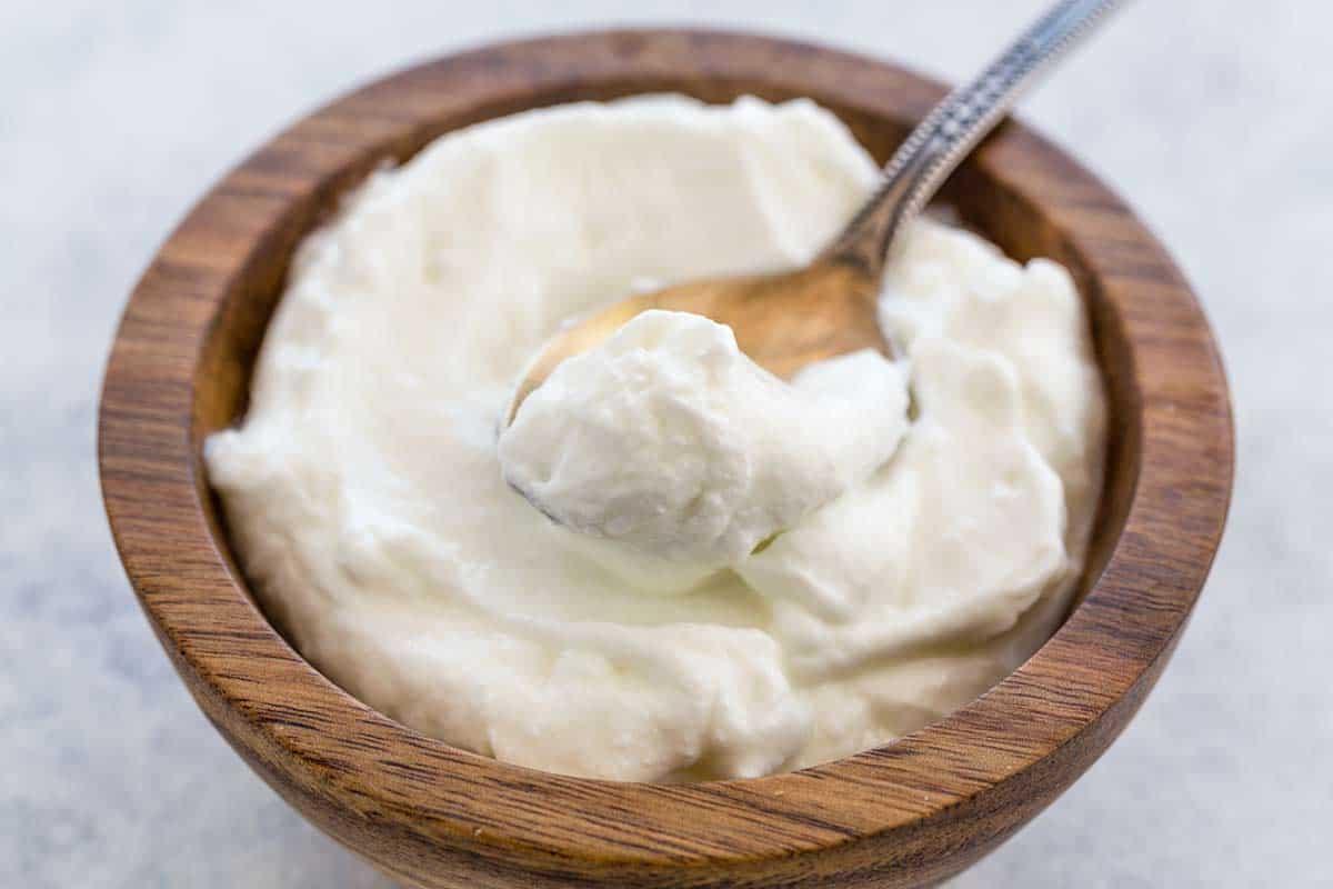 Spoon with yogurt