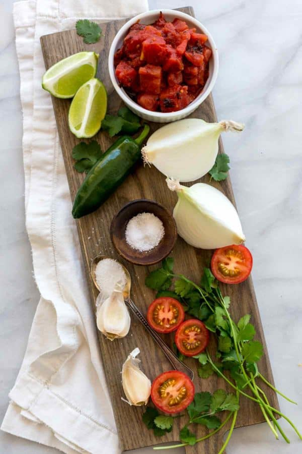 Ingredients for homemade salsa spread out on a table