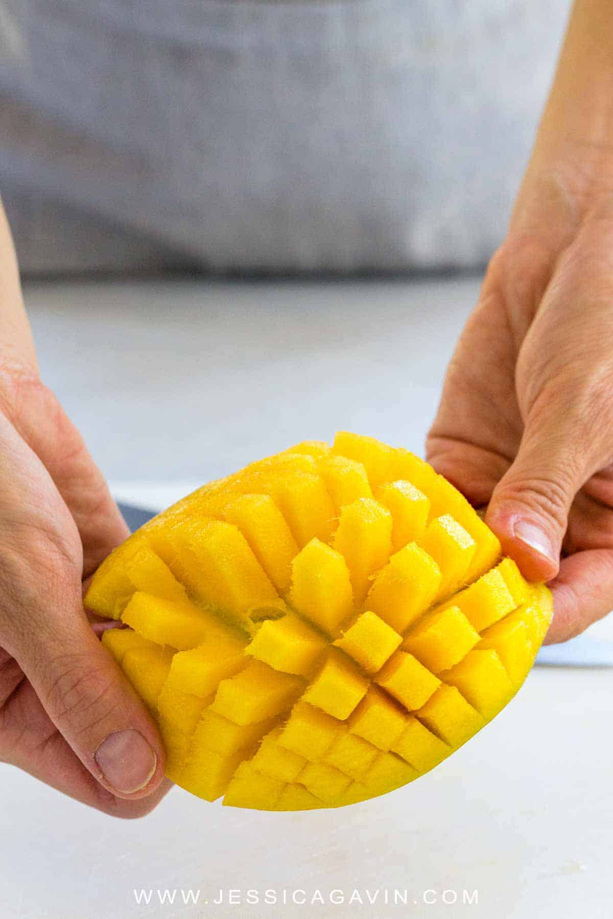 Learn how to cut a mango using a few simple techniques to yield the most fruit. The bright orange sweet flesh can be sliced or diced and be enjoyed as a stand-alone snack or added to various recipes. #mango #knifeskills #howto