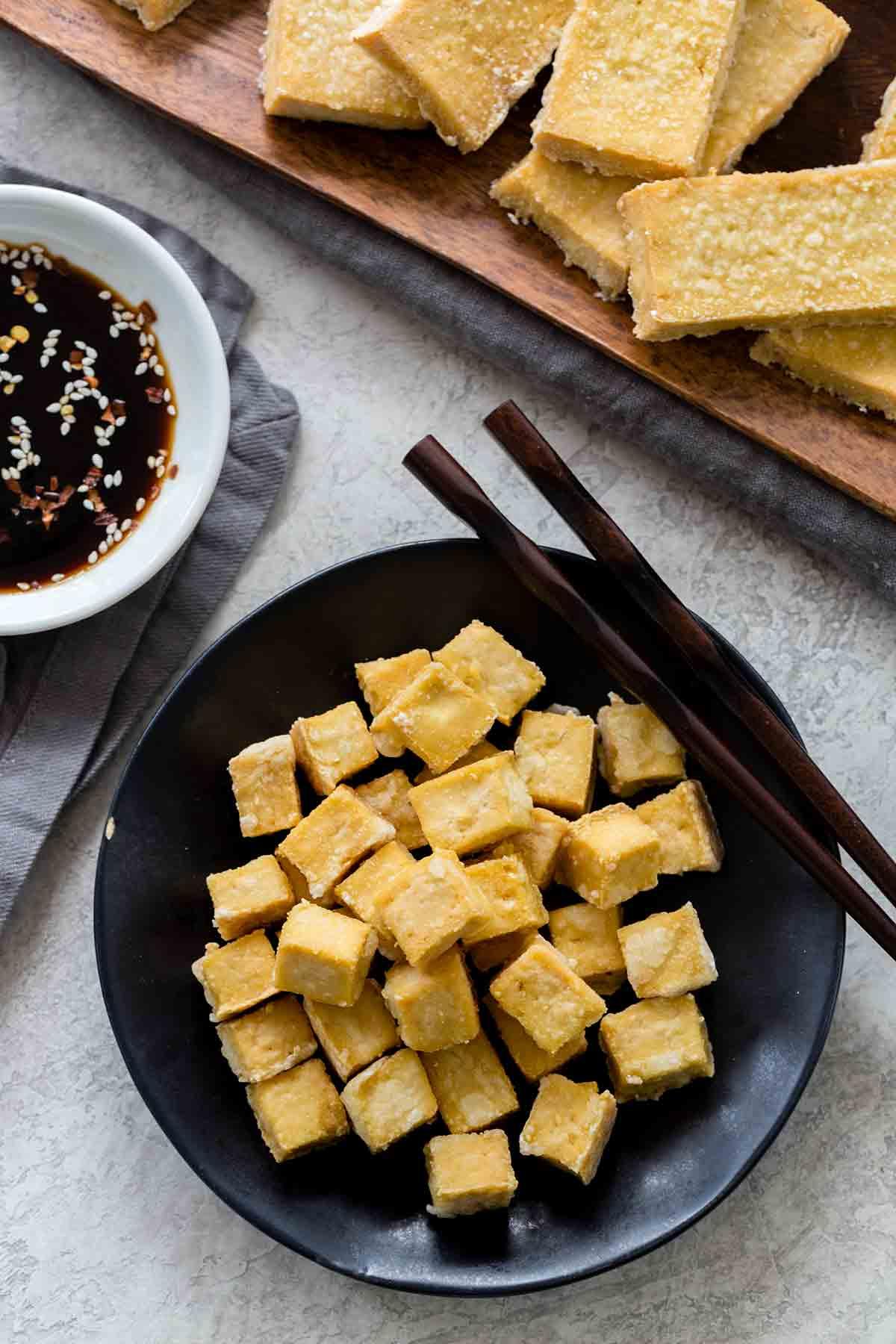 Bowl of crispy baked tofu cubes