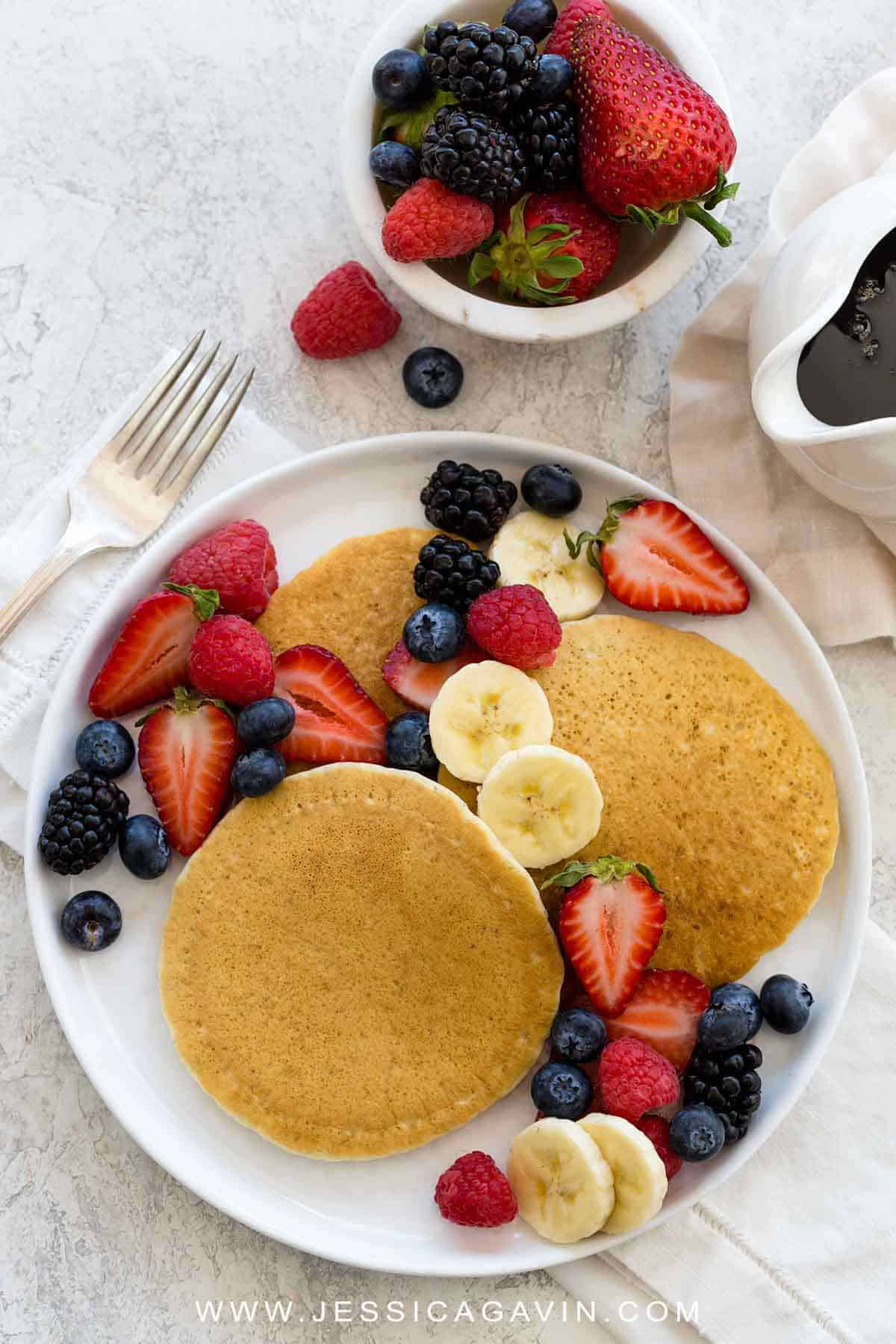 Vegan pancakes made with just a few simple ingredients. A combination of wheat flour, baking soda, baking powder, coconut oil, cashew milk, and ground flaxseed is used to make light, fluffy and golden brown pancakes. #veganpancakes #vegan #breakfast #pancakes