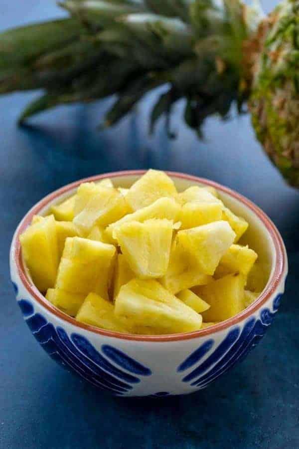 Bowl of fresh cut pineapple chunks