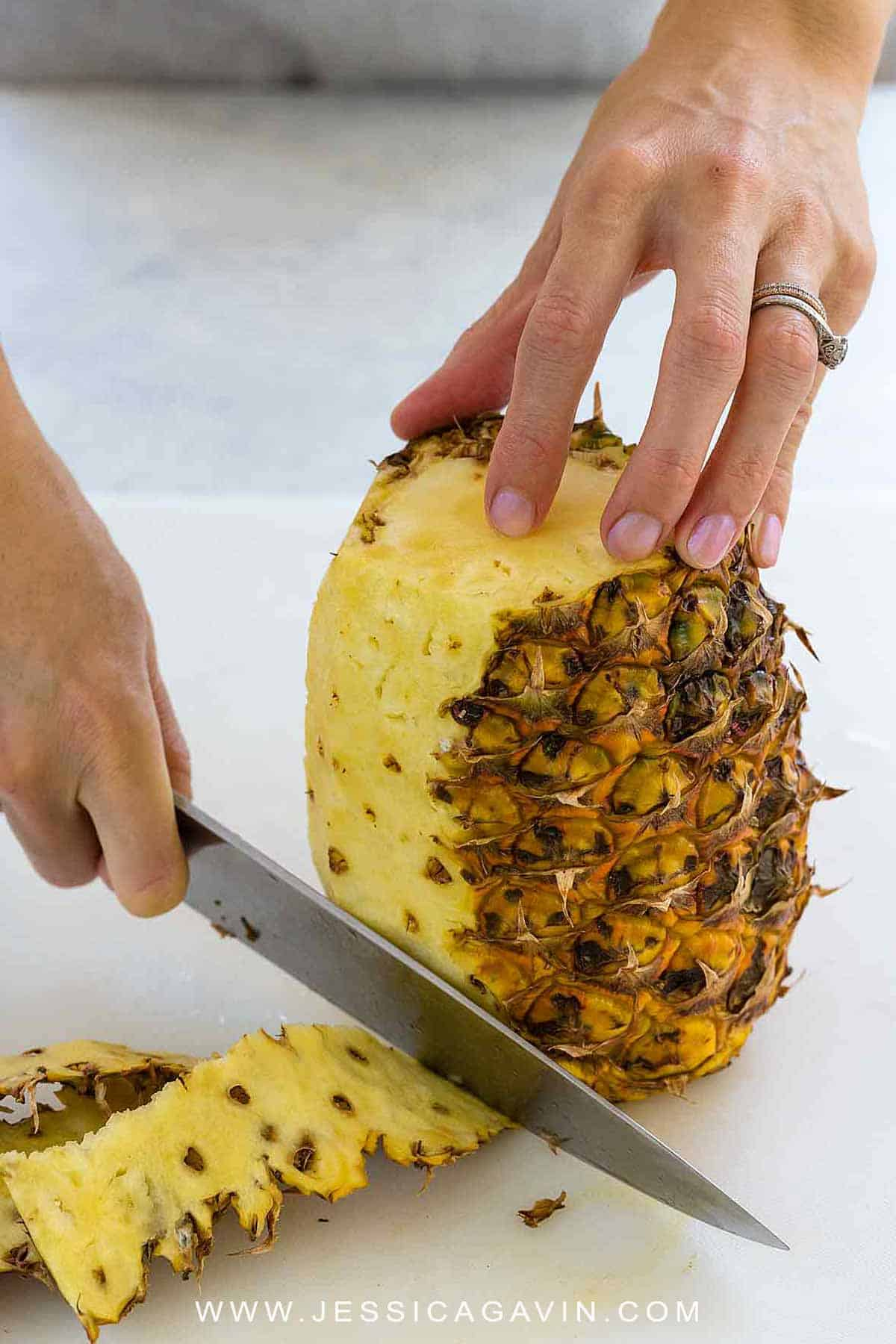 Learn how to cut a pineapple with this simple step-by-step guide. The sweet golden flesh can be sliced and diced for a tropical fruit snack or usedin various recipes. #howto #pineapple #knifeskills