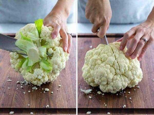 Persons hands cutting a head of cauliflower