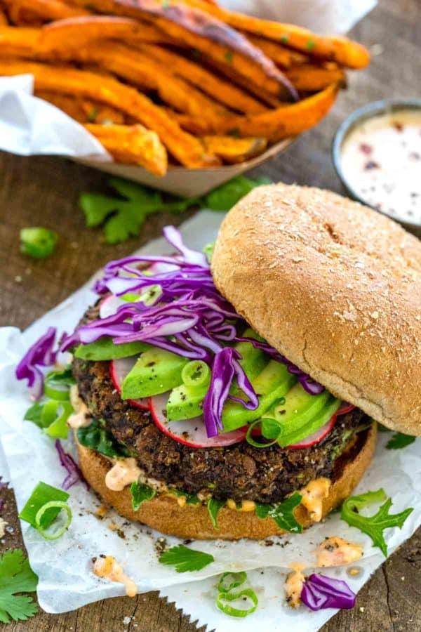 vegan black bean burger with a basket of sweet potato fries