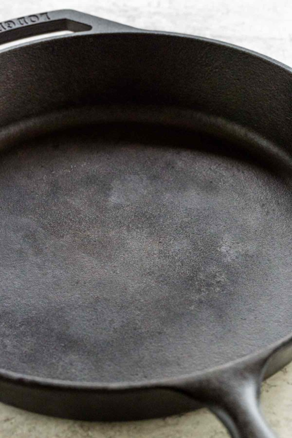 Clean surface of a cast iron skillet