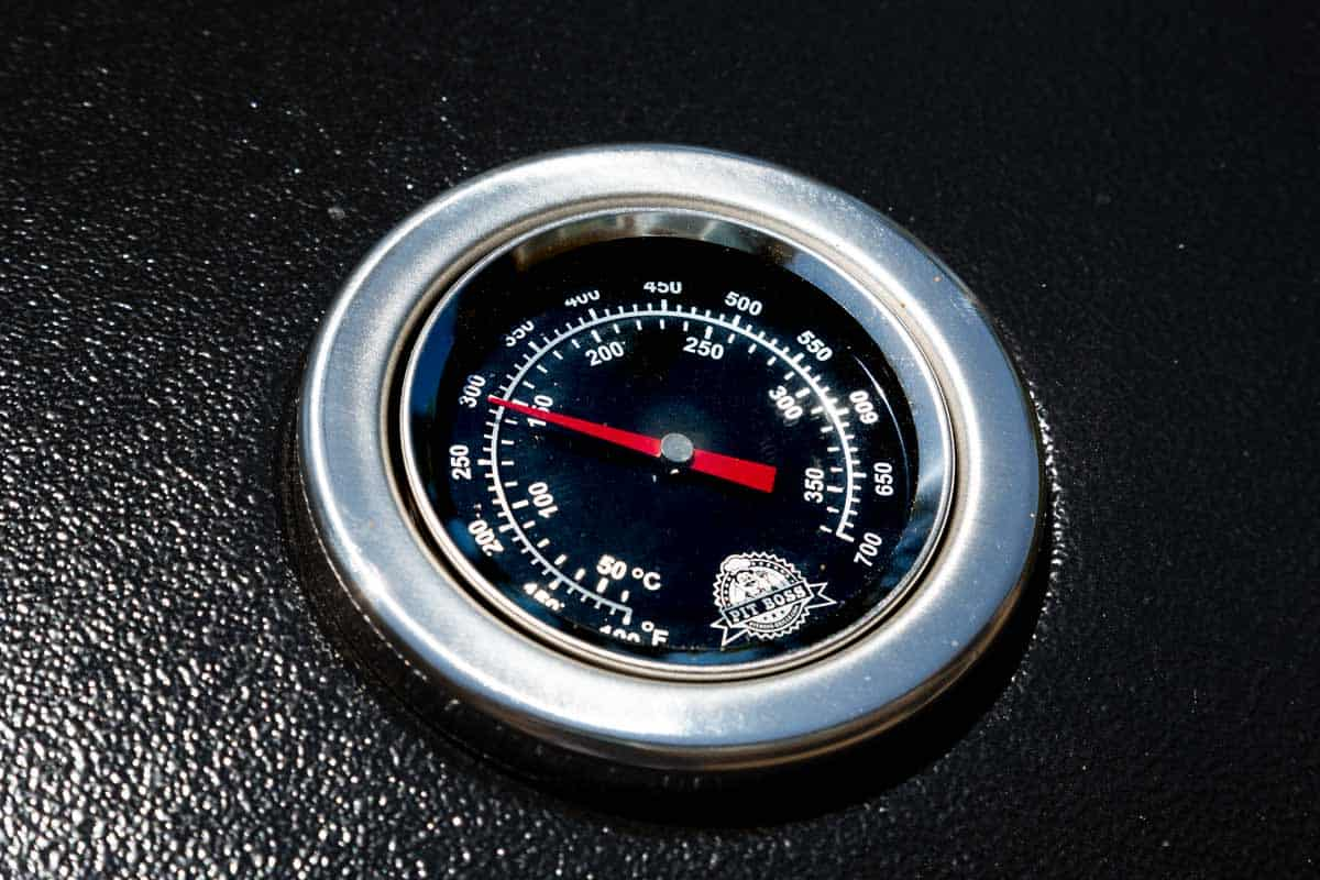 The temperature gauge on the lid of a barbecue