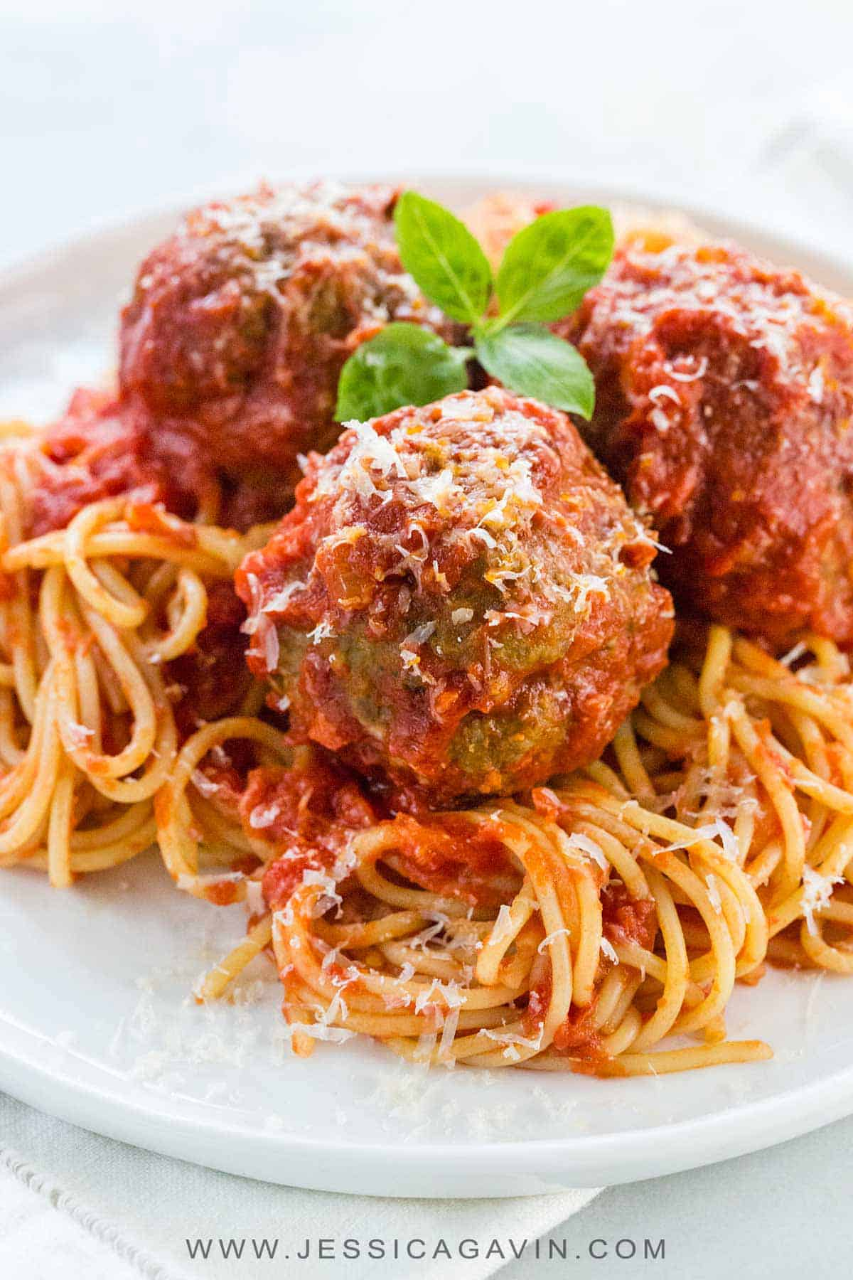 Grandma\'s Italian meatball recipe is the ultimate comfort food to share with the family! Tender and juicy meatballs simmered in a simple yet rich tomato sauce and placed over spaghetti noodles or the pasta of your liking. #meatballs #italianfood