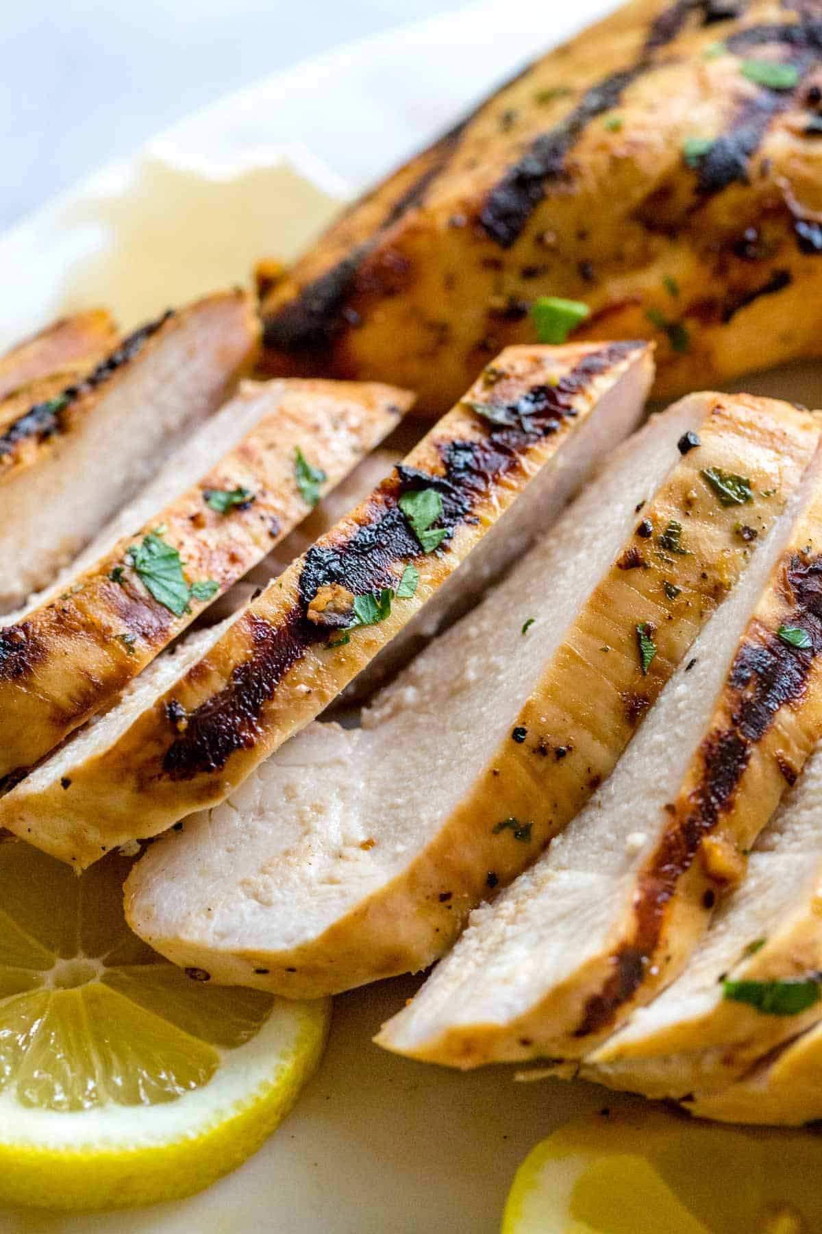 Flavorful chicken breasts sliced apart on a platter