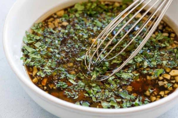 Whisk mixing homemade marinade