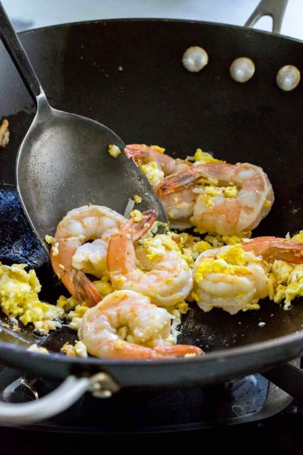 Shrimp and eggs cooking in a wok