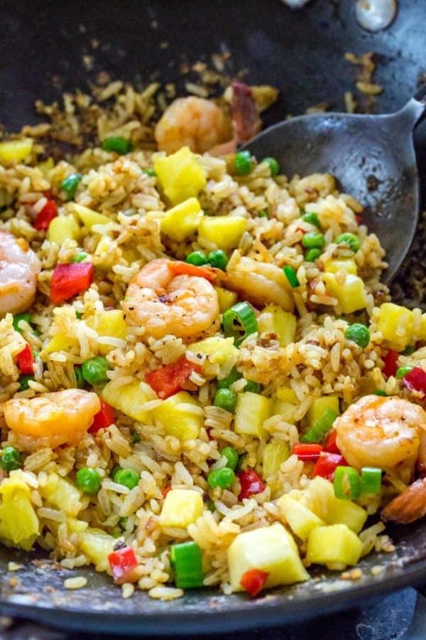 stir fry pineapple fried rice in a wok