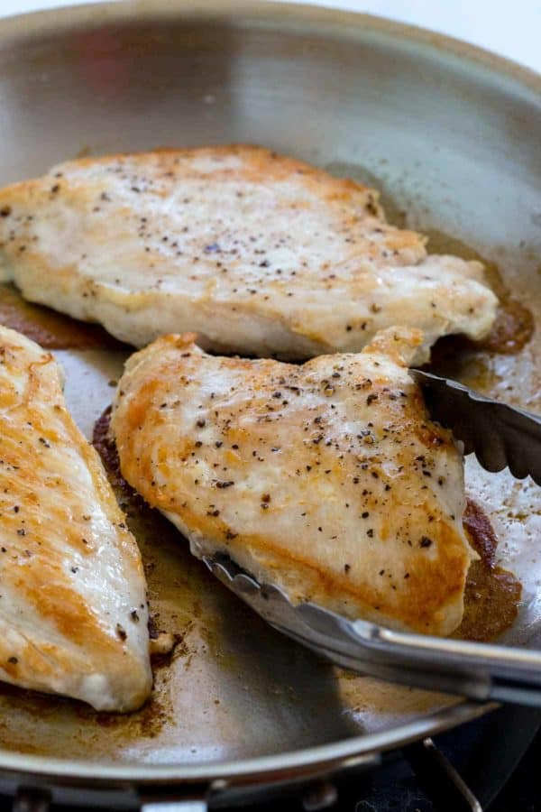 Sautéed chicken breasts in a frying pan