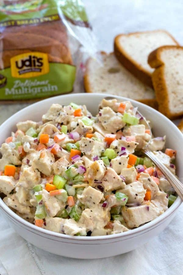 White bowl with chicken salad inside