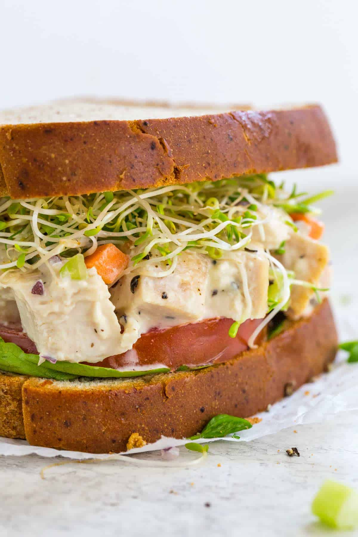 Closeup photo showing the inside of a chicken salad sandwich
