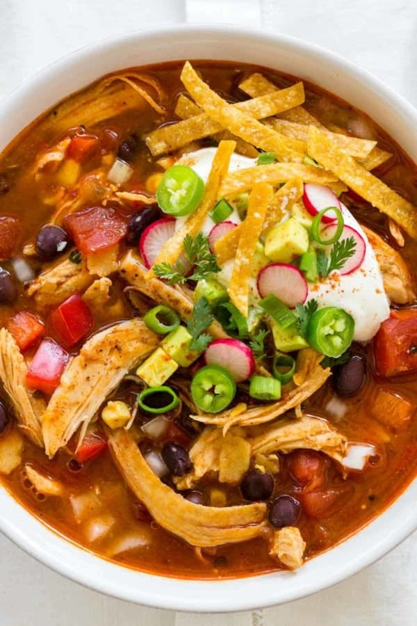 top down photo of white bowl with chicken tortilla soup