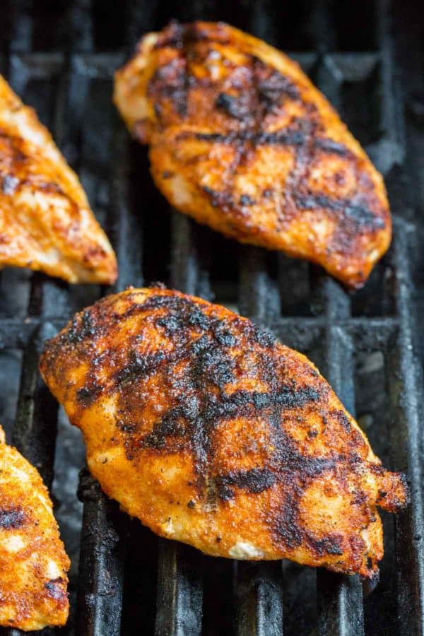 Grilled chicken breasts cooking on a barbecue grill