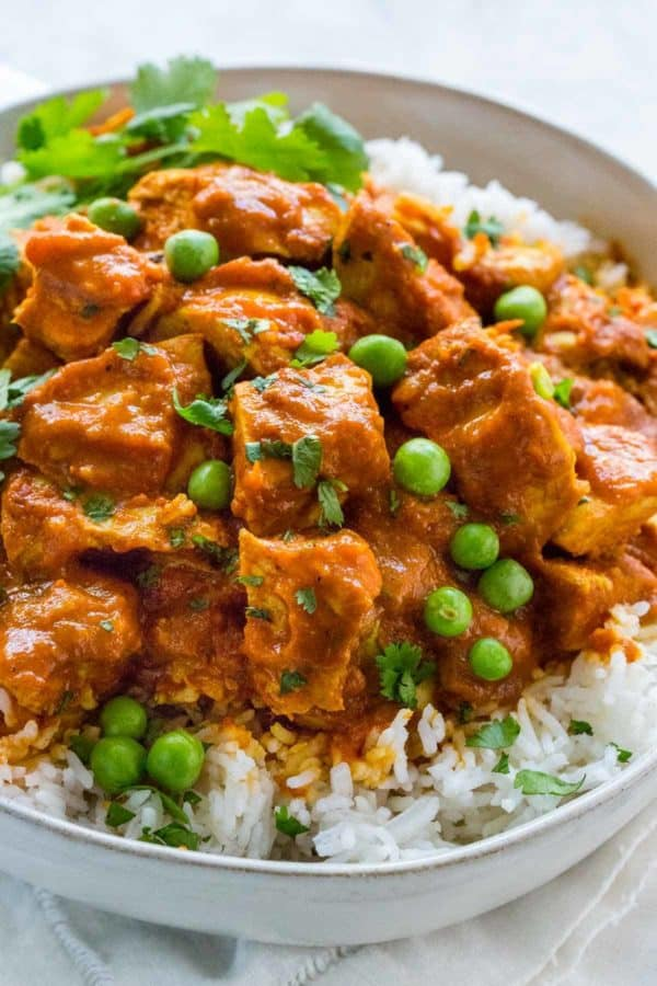 Instant Pot butter chicken in a bowl over white rice
