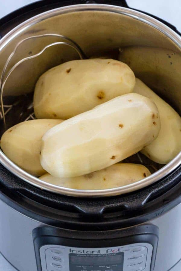 Peeled Russet potatoes placed inside an Instant Pot