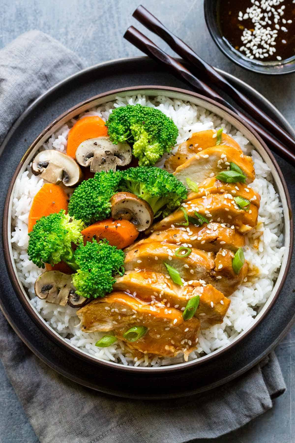 Instant Pot teriyaki chicken in a rice bowl with carrots and broccoli
