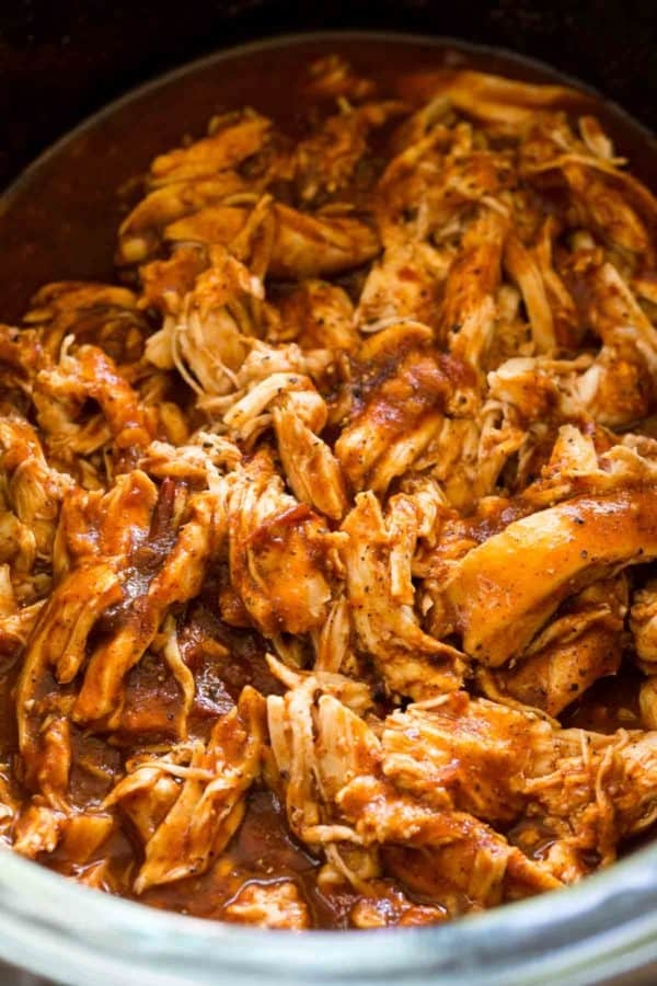 Shredded chicken simmering in mexican-spiced sauce