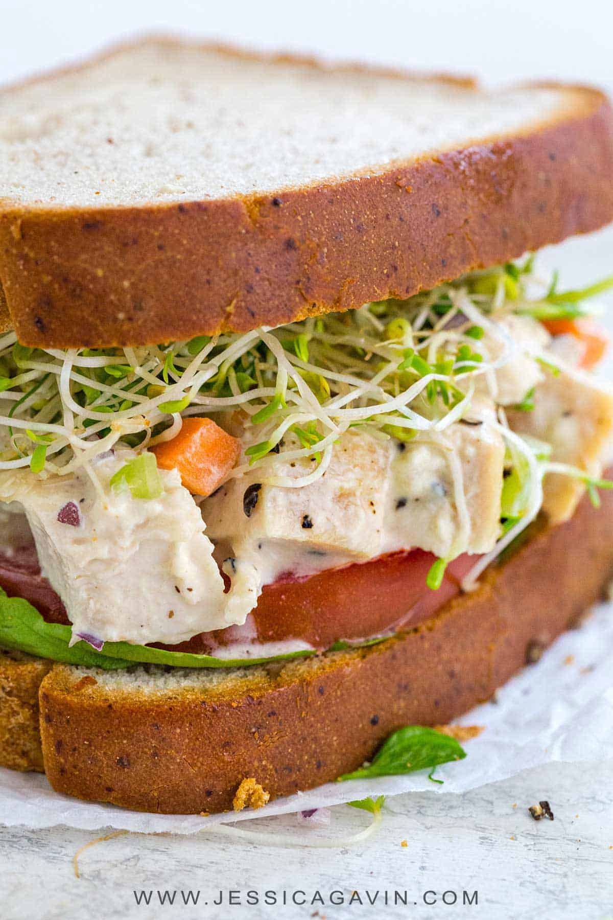 Chicken salad sandwich with tender bites of lean protein mixed with crunchy vegetables that are tossed in a creamy mustard sauce. #lunch #sandwich #chickensalad