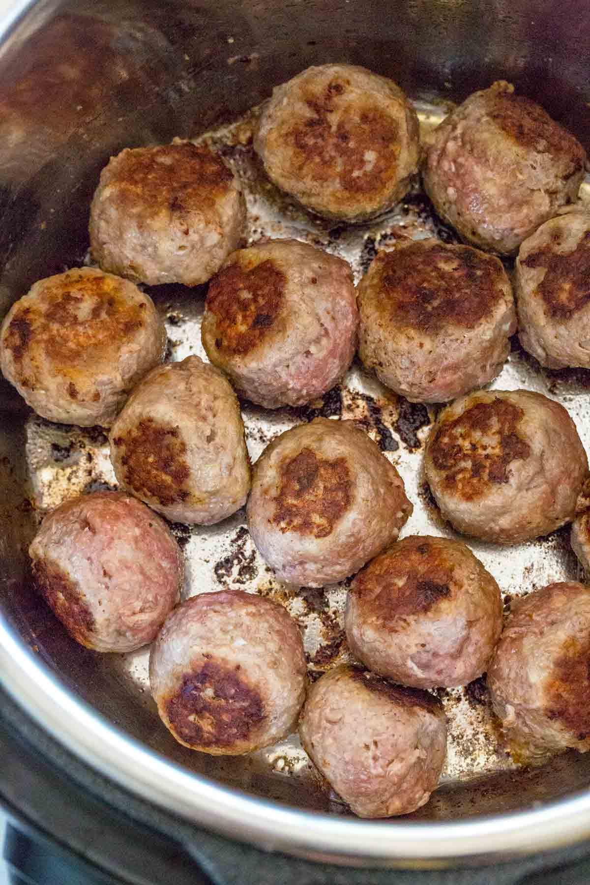 meatballs being sautéed inside an Instant Pot