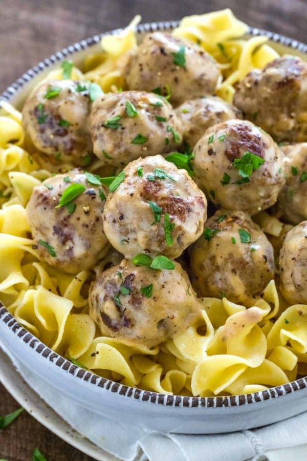 Swedish meatballs served in a bowl with egg noodles