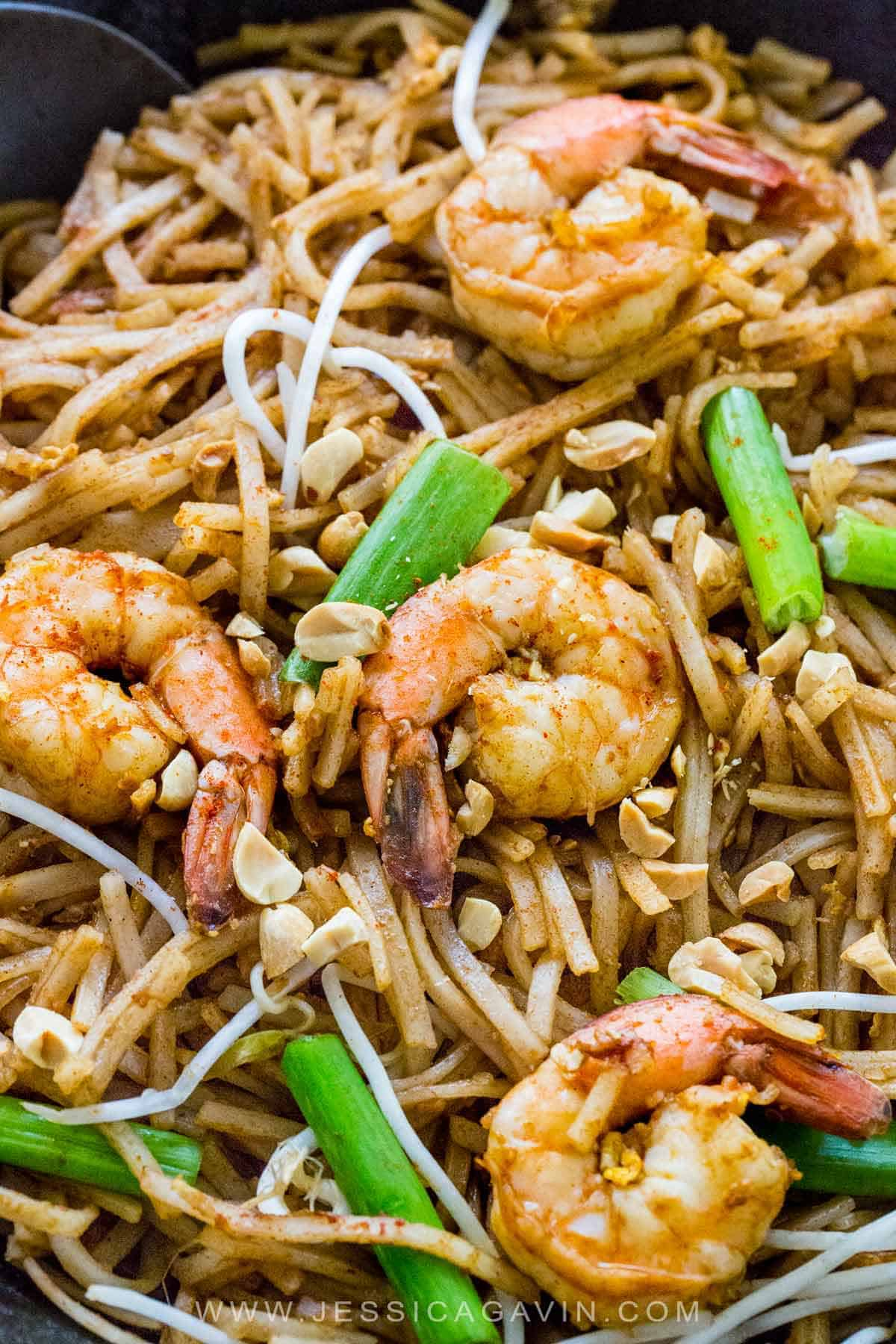 Pad Thai noodles stir-fried and tossed in a flavorful sauce. This authentic recipe features succulent shrimp, but you can also use chicken, beef, tofu or a combination. #padthai #thairecipes #shrimp