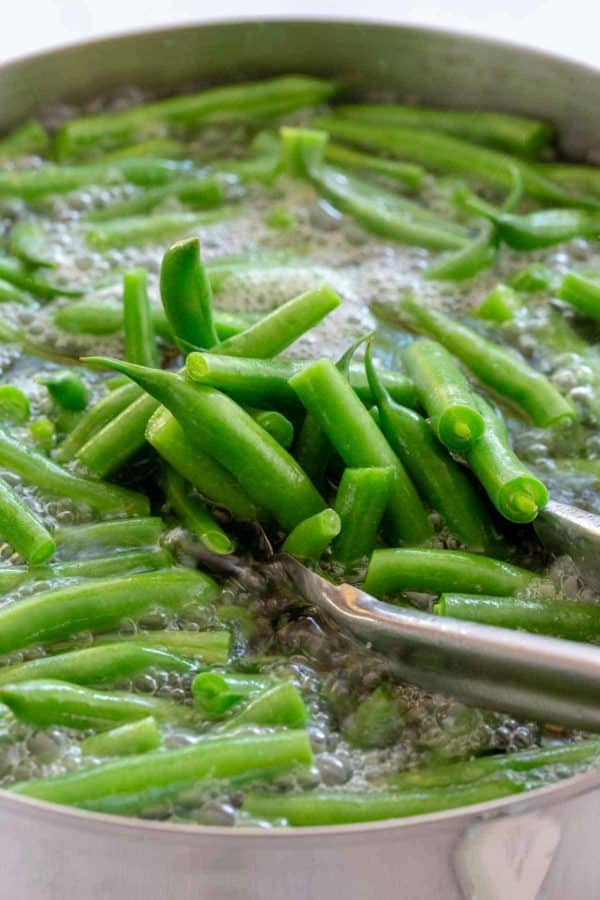 green beans cooking in a boiling pot of water