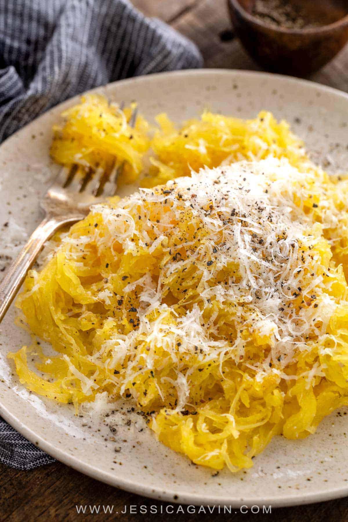 Low carb version of Italian Cacio e Pepe recipe that is lightened up by substituting roasted spaghetti squash for pasta noodles. #spaghettisquash #italianrecipe #lowcarb #skinnytaste
