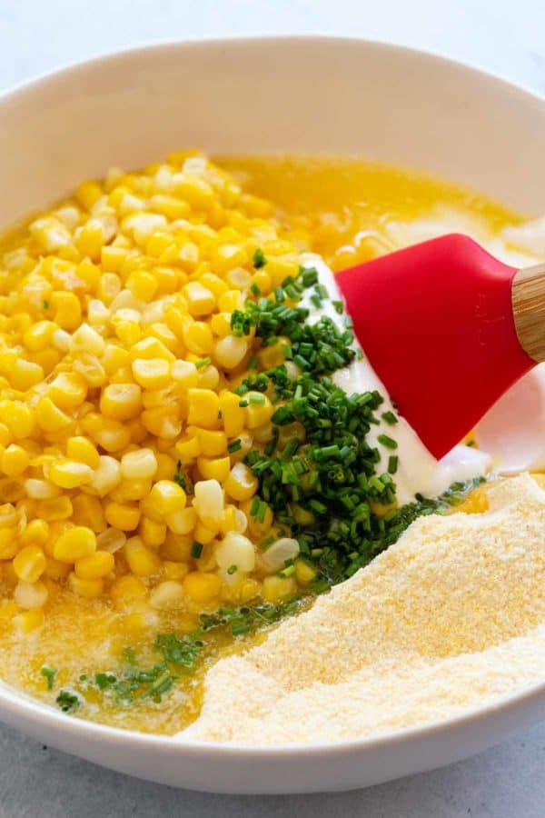 corn casserole ingredients in a bowl about to be mixed together
