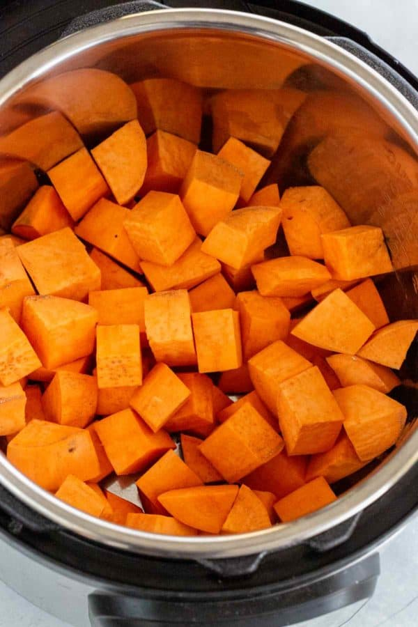 1-inch diced cubes of sweet potatoes inside an Instant Pot