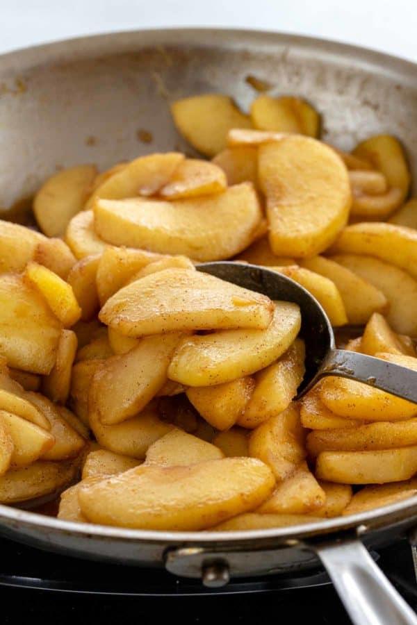 Honeycrisp apple slices sautéing in a pan