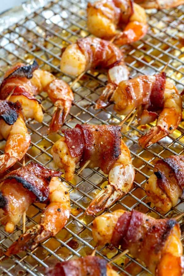 close up photo of crispy bacon wrapped around shrimp