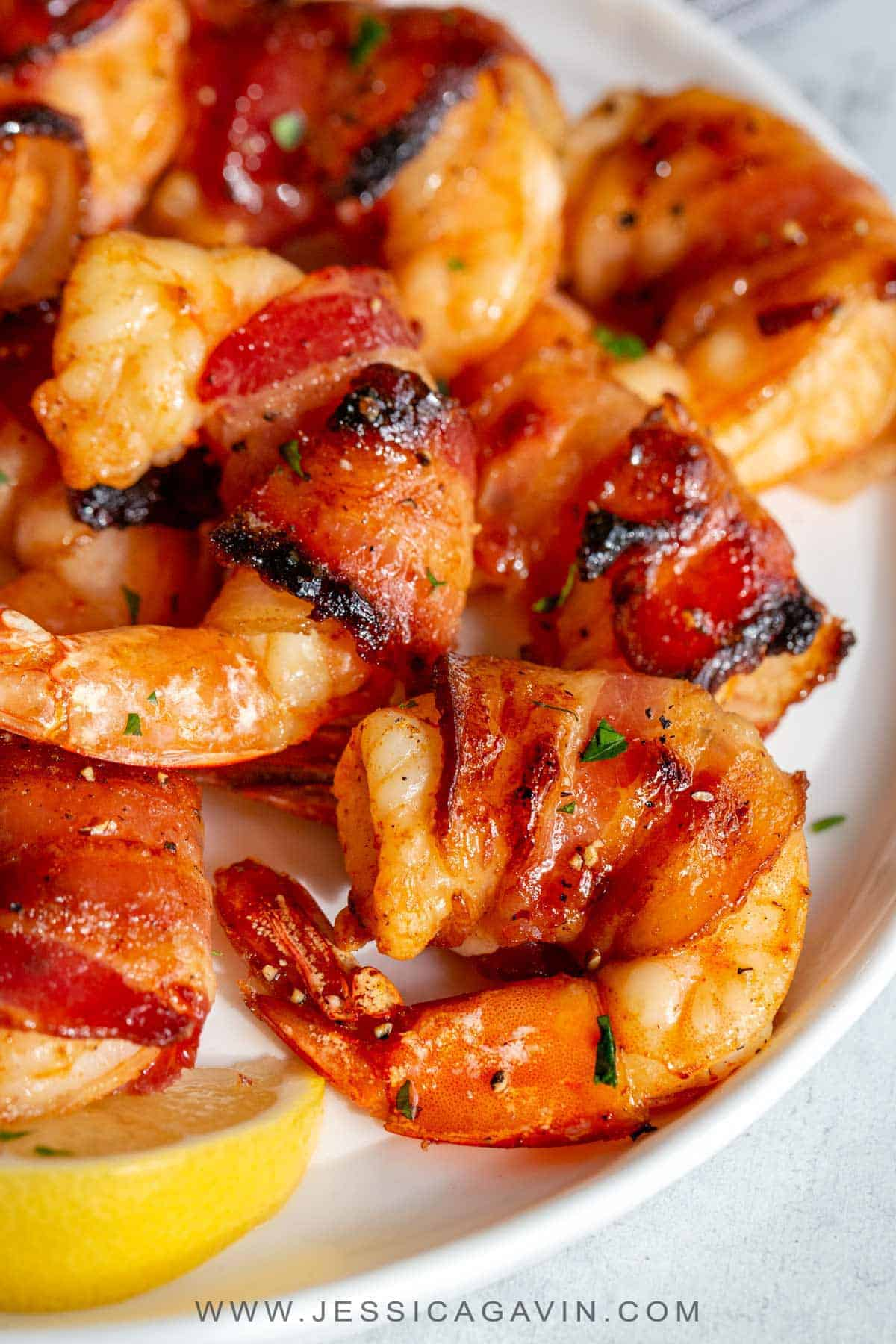 Bacon wrapped shrimp appetizer that\'s guaranteed to impress. Bacon is by par-cooked first before wrapping around marinated shrimp with a maple glaze. #baconshrimp #bacon #appetizer