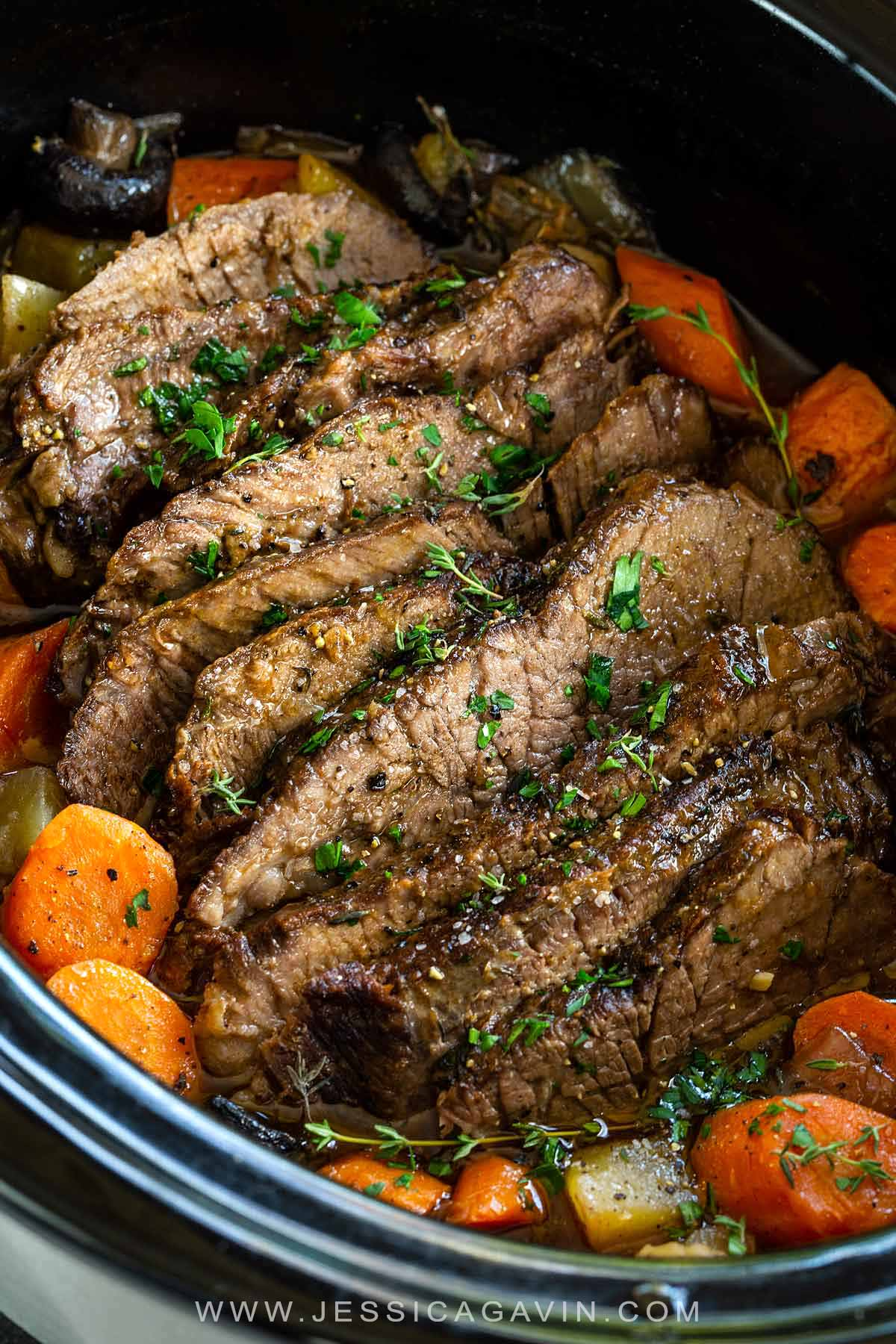 Slow cooker pot roast recipe that browns the beef first to enhance flavor then potatoes, onion, and carrots cook alongside the meat for a complete dinner. #potroast #slowcooker #crockpot #beefrecipe